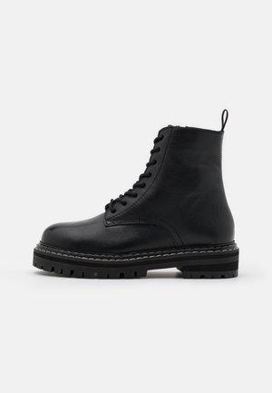 REINE - Platform ankle boots - noir