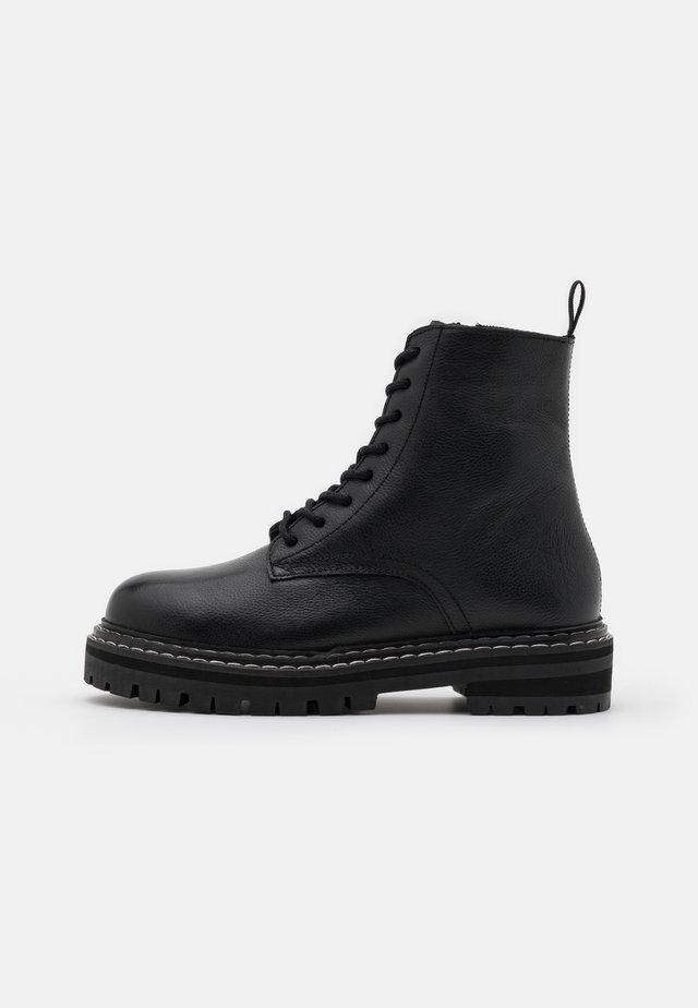 REINE - Lace-up ankle boots - noir