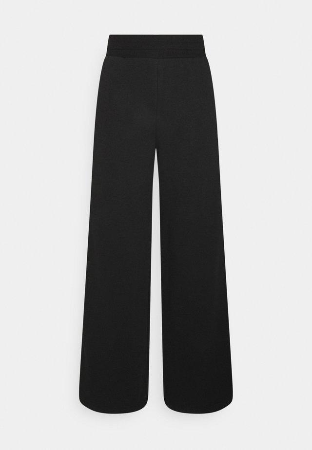EMBROIDERED WIDE PANTS - Pantaloni sportivi - black
