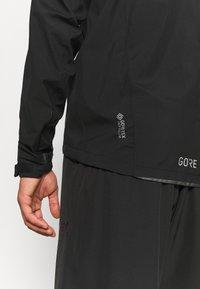 Gore Wear - GORE® WEAR SPIRIT JACKET MENS - Trainingsjacke - black - 4