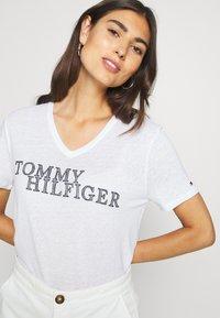 Tommy Hilfiger - CHRISTA REGULAR - T-shirts med print - white - 5