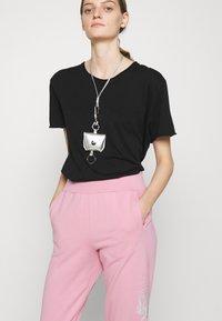 KARL LAGERFELD - RHINESTONE LOGO PANTS - Tracksuit bottoms - pink - 3