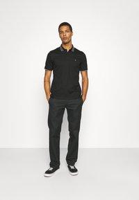 Calvin Klein Tailored - LIQUID TOUCH TIPPING SLIM - Polo shirt - black - 1