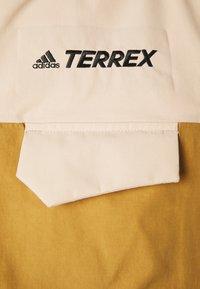adidas Performance - TERREX XPLORIC RAIN - Hardshell jacket - halo blush/mesa - 9