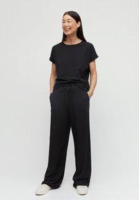 ARMEDANGELS - HANNAA - Trousers - black - 1
