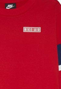 Nike Sportswear - AIR - Long sleeved top - university red/blue void/whit - 3