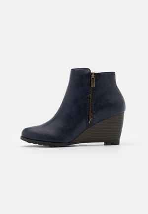 ASTONISHING - Ankle boot - navy