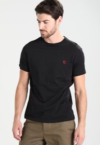Timberland - CREW CHEST - Basic T-shirt - black - 0