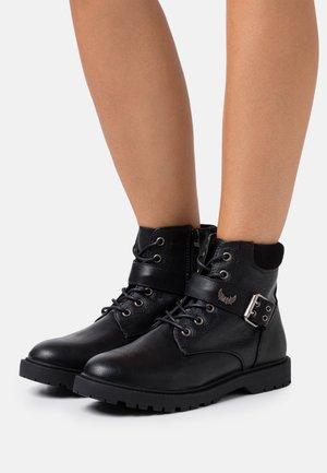 TOSCANE - Lace-up ankle boots - noir
