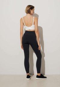 OYSHO - Medium support sports bra - white - 1