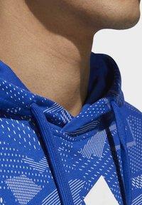 adidas Performance - ESSENTIALS ALLOVER PRINT HOODIE - Hoodie - blue - 5
