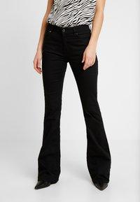 Ivy Copenhagen - CHARLOTTE SERIOUSLY - Flared Jeans - black - 0