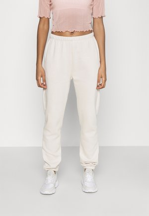 COZY PANTS - Tracksuit bottoms - cream