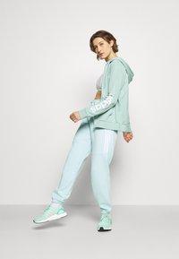 adidas Performance - SPORT - Pantalones deportivos - halo mint - 1
