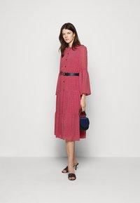 MICHAEL Michael Kors - PRINTED BELTED SHIFT DRESS - Shirt dress - crimson - 1