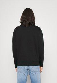 Calvin Klein Jeans - NEW ICONIC ESSENTIAL CREW NECK UNISEX - Sweatshirt - black - 2