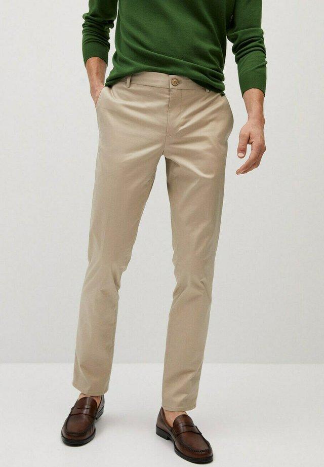 DUBLIN7 - Trousers - beige