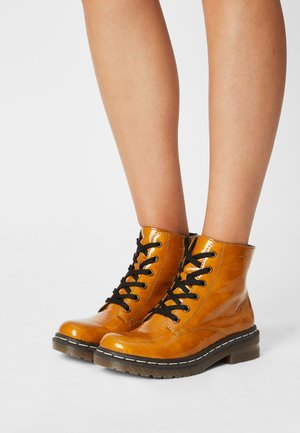 Lace-up ankle boots - gelb