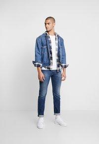 Diesel - BUSTER - Slim fit jeans - blue denim - 1