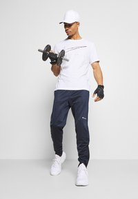 Champion - LEGACY CUFF PANTS - Tracksuit bottoms - dark blue - 1