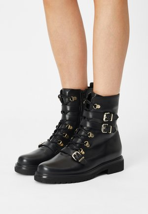 Lace-up ankle boots - schwarz/gold