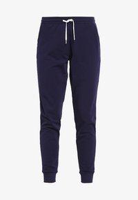 Zalando Essentials - Pantalones deportivos - navy - 3