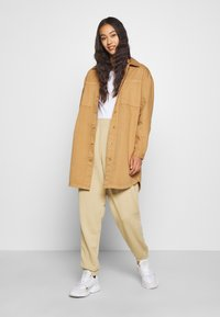 adidas Originals - CUFFED  - Tracksuit bottoms - linen khaki - 1