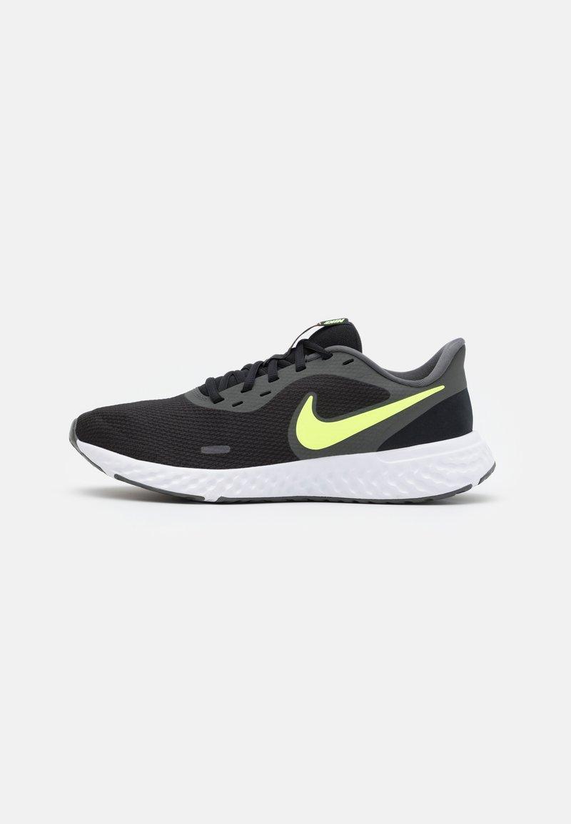 Nike Performance - REVOLUTION 5 - Zapatillas de running neutras - black/white/university gold/volt glow