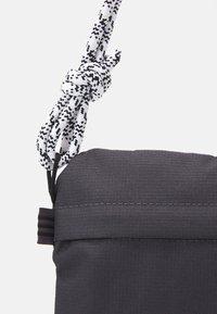 adidas Originals - SIMPLE POUC UNISEX - Across body bag - solid grey/white/black - 3