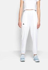 Kappa - IVYNALA - Tracksuit bottoms - bright white - 0