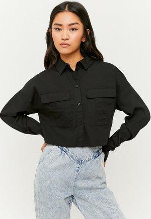 MIT KNÖPFE - Button-down blouse - black