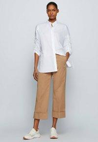 BOSS - TAROMA - Trousers - beige - 1