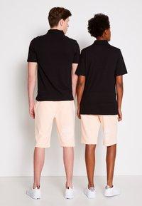 Tommy Hilfiger - ONE PLANET SMALL LOGO UNISEX - Polo shirt - black - 2