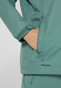 Vaude - WOMANS ESCAPE LIGHT JACKET - Waterproof jacket - nickel green - 6