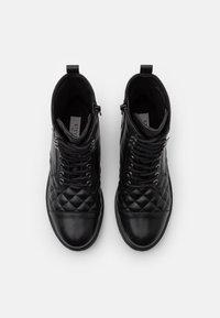 Steven New York - QUVI - Šněrovací kotníkové boty - black - 5