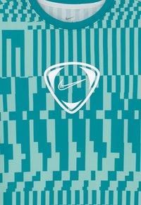 Nike Performance - DRY UNISEX - Print T-shirt - light dew/aquamarine/white - 2