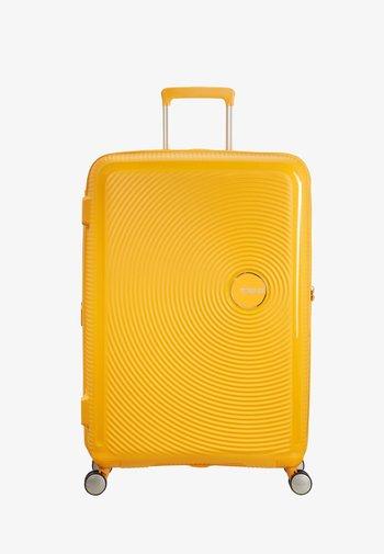 SOUNDBOX - Wheeled suitcase - golden yellow