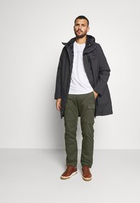 Jack Wolfskin - ARCTIC ROAD CARGO - Outdoor trousers - brownstone - 1