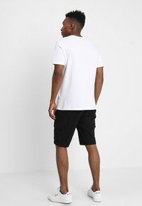 YOURTURN - Shorts - black - 2