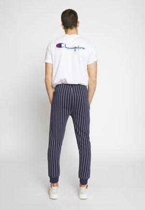 LEREDO - Tracksuit bottoms - navy