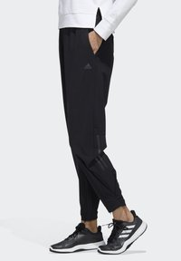 adidas Performance - STRETCHABLE WOVEN JOGGERS - Tracksuit bottoms - black - 2
