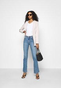 ONLY - ONLHUSH LIFE - Flared jeans - medium blue denim - 1