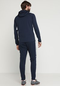 Nike Performance - DRY ACADEMY - Tracksuit bottoms - obsidian/white/white - 2