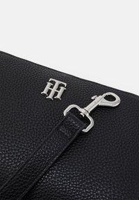 Tommy Hilfiger - ESSENCE CROSSOVER - Across body bag - black - 3