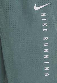 Nike Performance - Sports shorts - hasta/black - 5