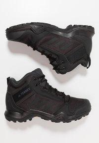 adidas Performance - TERREX AX3 MID GORE-TEX - Hiking shoes - clear black/carbon - 1