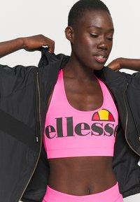Ellesse - PRESELLE - Medium support sports bra - neon pink - 3