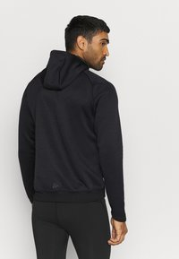 Craft - CHARGE ZIP HOOD JACKET - Sports jacket - black - 2