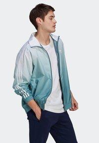 adidas Originals - ADICOLOR 3D TREFOIL 3-STRIPES OMBRÉ TRACK TOP - Training jacket - white - 2