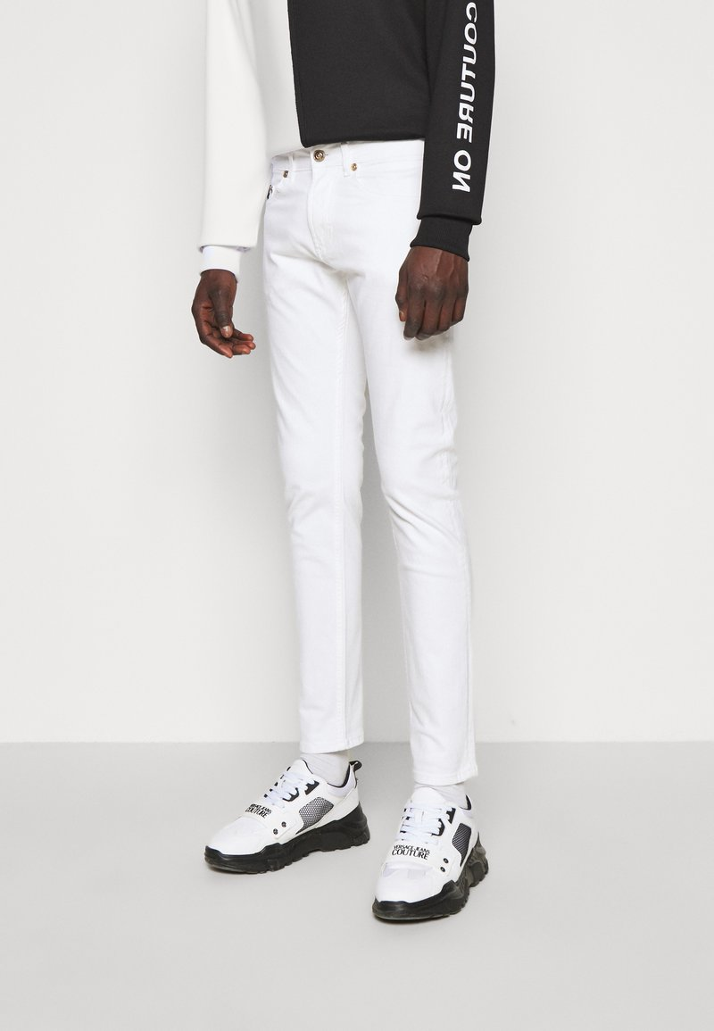 Versace Jeans Couture - DRILL - Straight leg jeans - white
